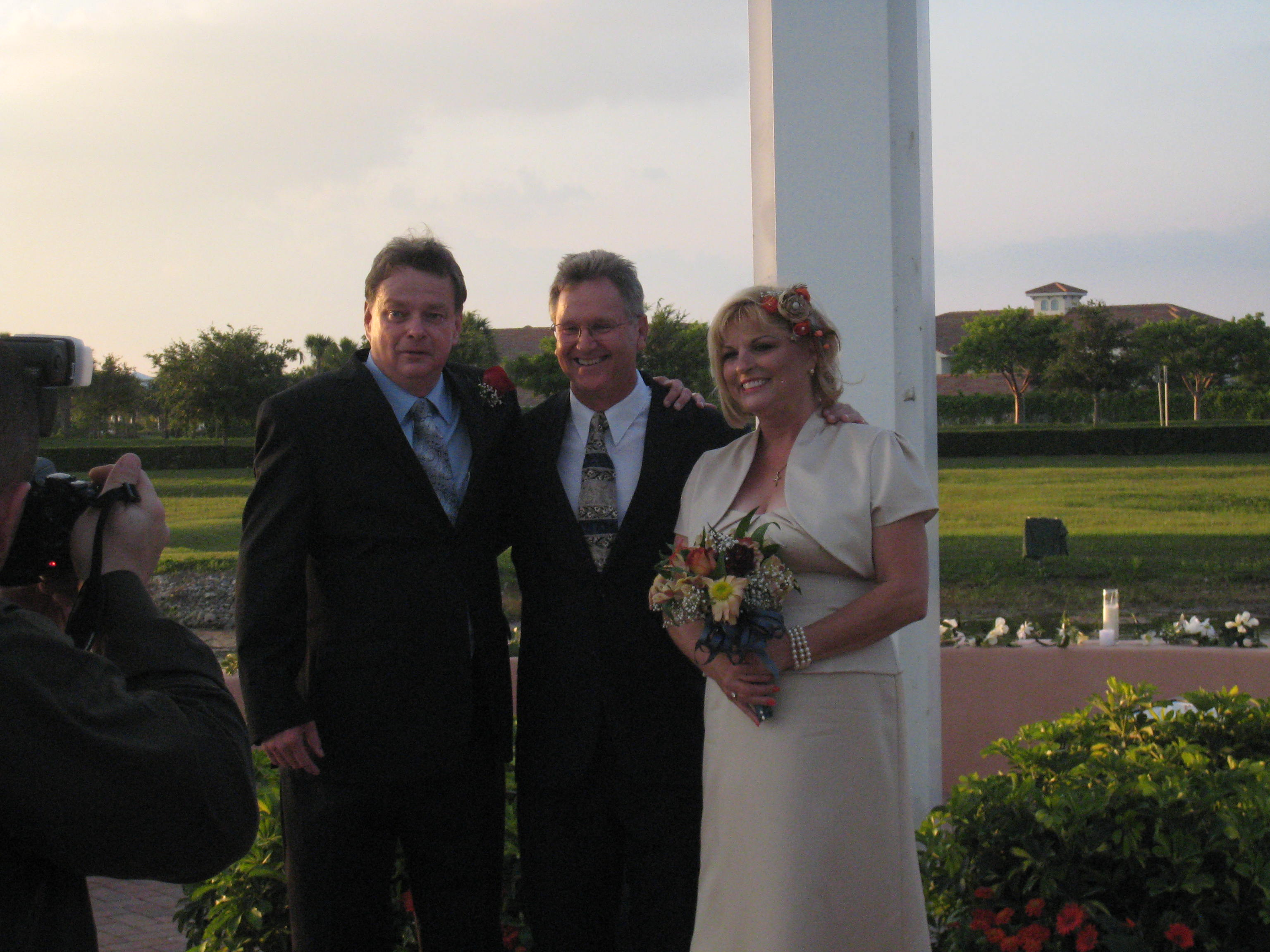 Pastor Tom Lewis just married us!